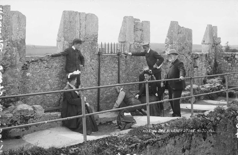 Kissing_the_Blarney_Stone_1897